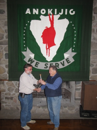 "Jim Scherer Passes ""Flame of Leadership"" To Darin Holden"