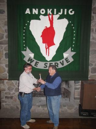 "Jim Scherer Passes ""Flame of Leadership"" To Darin Holden"